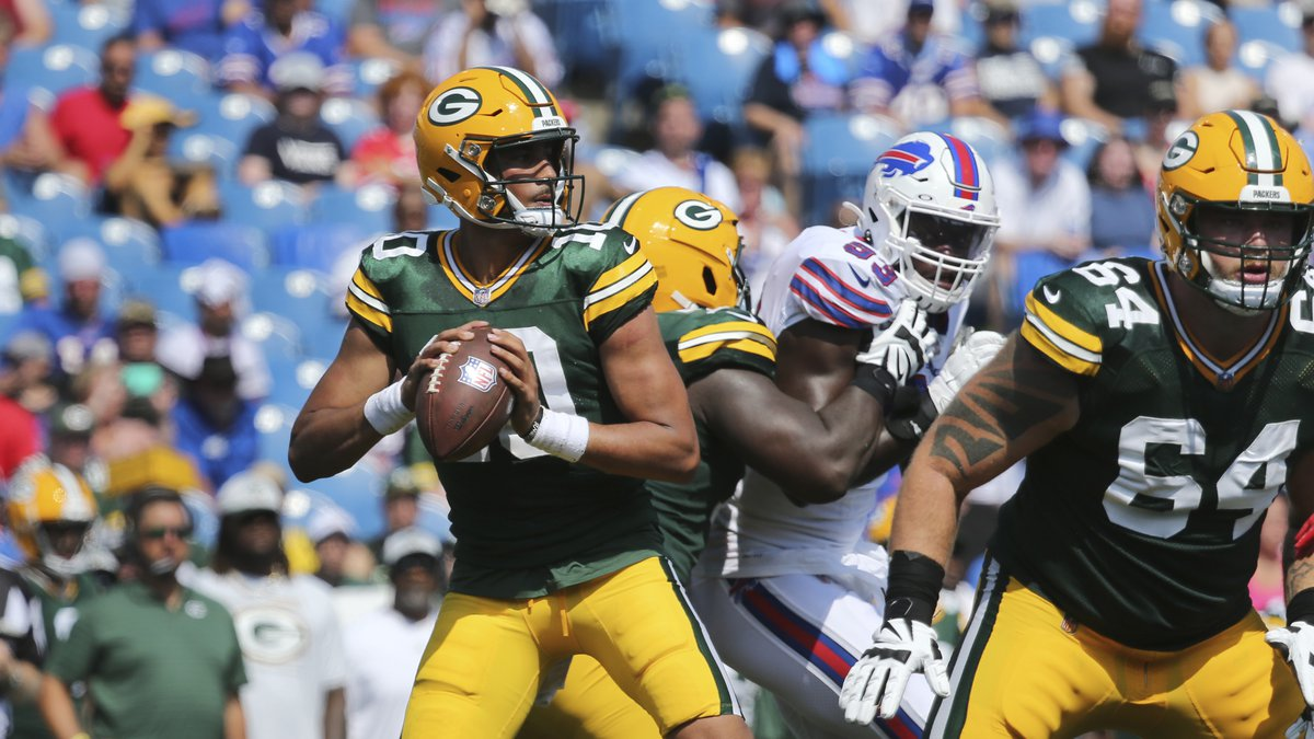 Green Bay Packers quarterback Jordan Love, left, looks to pass during the second half of a...