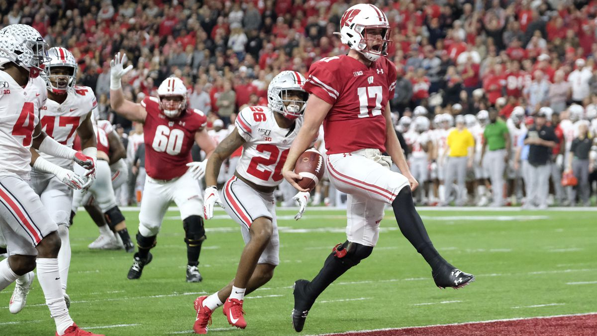 Wisconsin quarterback Jack Coan (17) runs in for a touchdown past Ohio State cornerback Cameron...