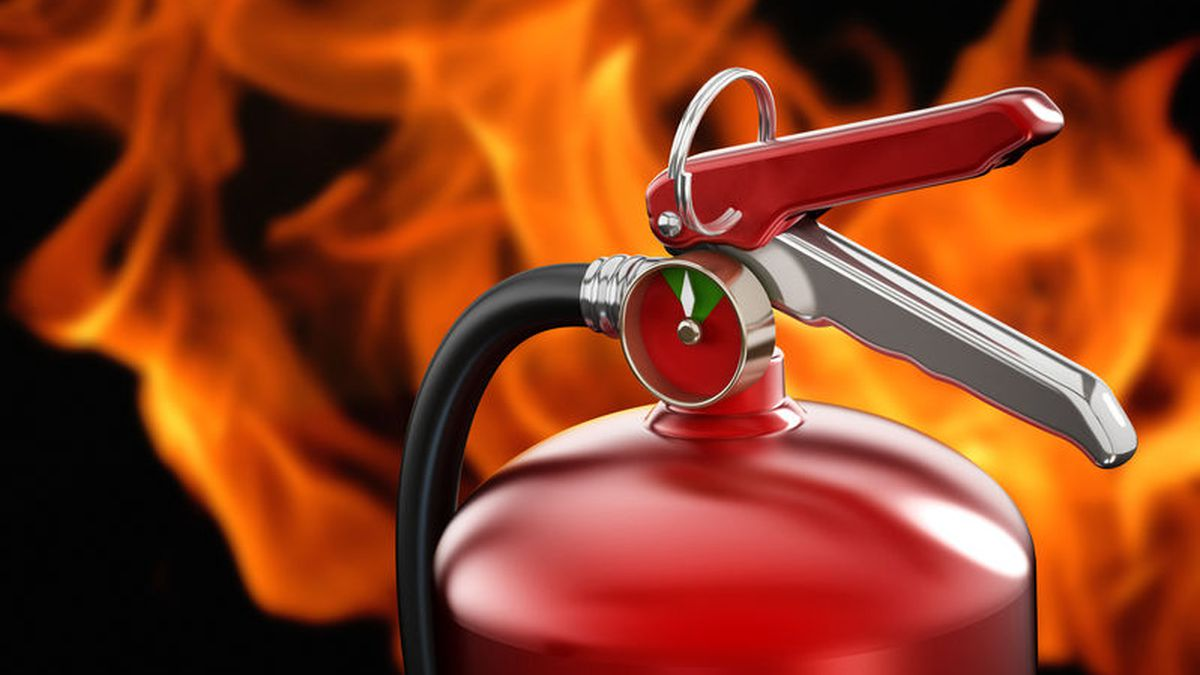 Fire extinguisher on flame background.