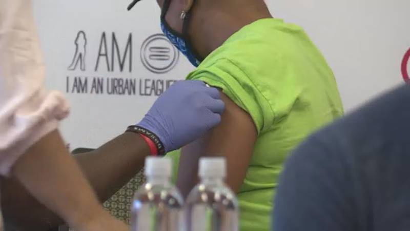 A woman receives a COVID-19 vaccine at the Urban League of Greater Madison on May 25, 2021.