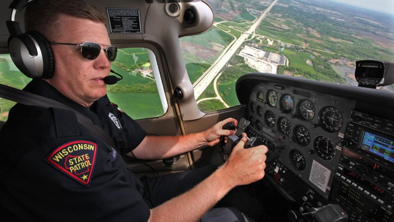 A Wisconsin State Patrol pilot conducts aerial enforcement of traffic laws.
