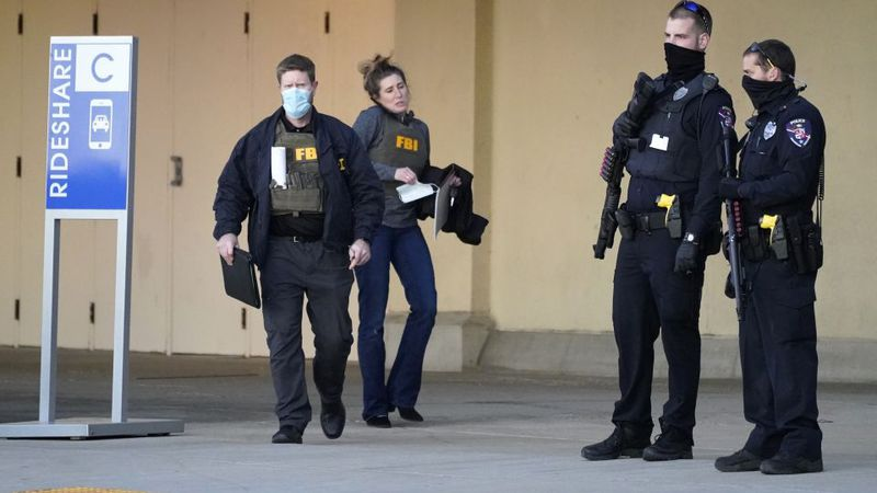Police and FBI agents investigate a shooting at the Mayfair Mall, Friday, Nov. 20, 2020, in...