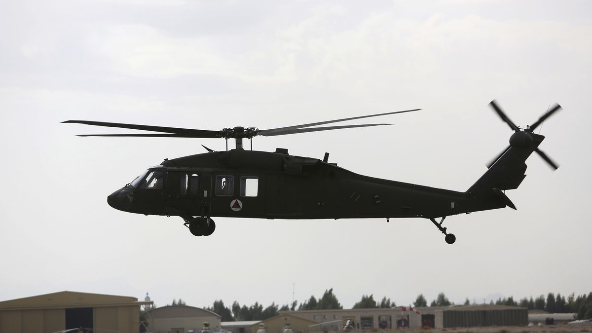 In this Monday, March 19, 2018 photo, UH-60 Black Hawk helicopters carrying US and Afghan trainees take off at Kandahar Air Field, Afghanistan. (AP Photo/Rahmat Gul)