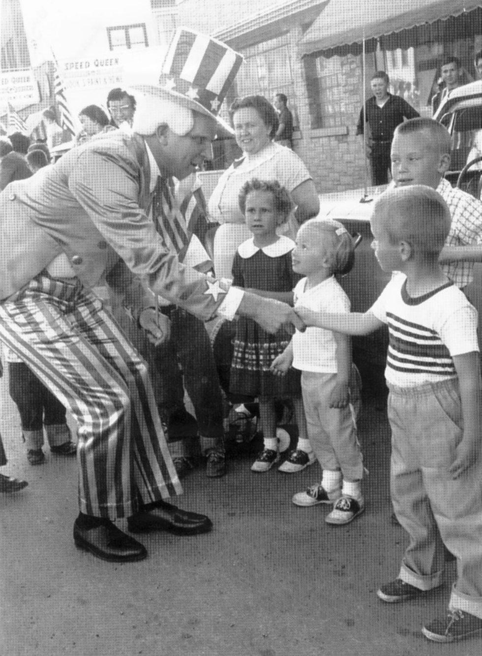 Bill Leppien greets children as Uncle Sam.
