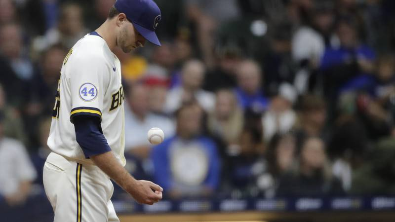 Milwaukee Brewers' Jake Cousins tosses the ball as he walks back to the mound after a...