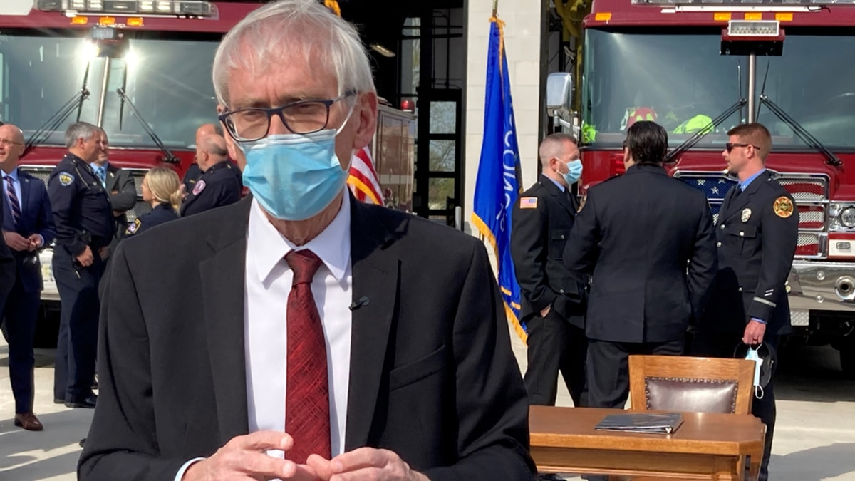 FILE - In this April 27, 2021, file photo, Wisconsin Gov. Tony Evers speaks with media at a...