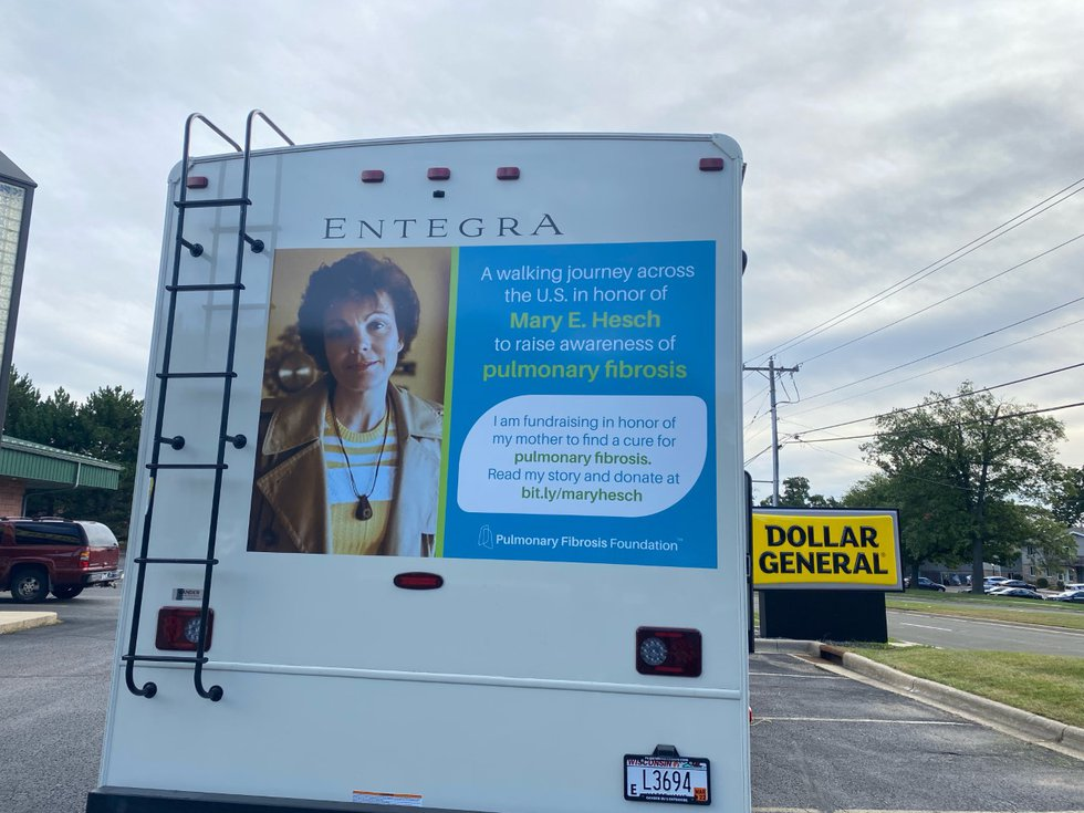 Mary Hesch promotes her fundraiser on the back of the RV she and friends are staying in during...