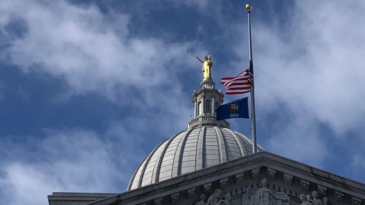 Flags fly at half-staff at the Wisconsin State Capital in Madison, Wisconsin, on Feb. 27, 2020. (WMTV/Jeremy Nichols)