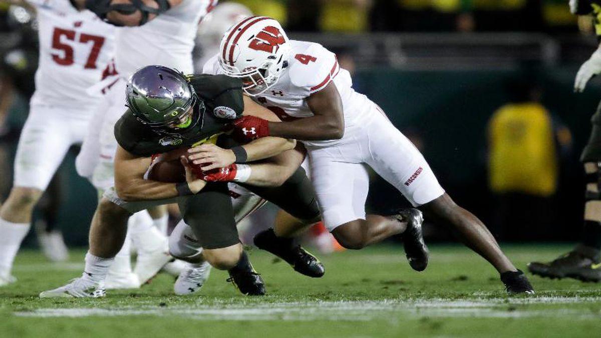 Wisconsin cornerback Donte Burton sacks Oregon quarterback Justin Herbert during second half of the Rose Bowl. (AP Photo/Marcio Jose Sanchez)