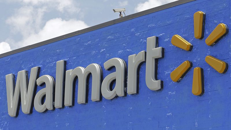 FILE - This June 1, 2017 file photo shows a Walmart sign at a store in Hialeah Gardens, Fla.