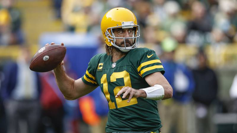Green Bay Packers quarterback Aaron Rodgers (12) looks to pass the ball during the first half...