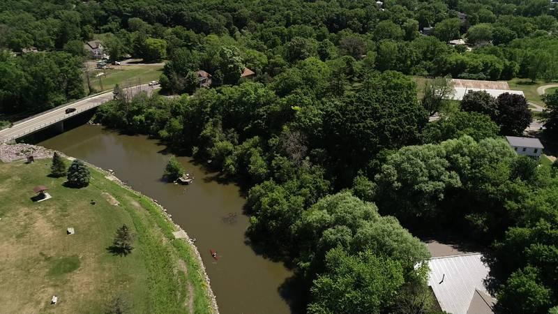 John Stofflet kayaks along the Baraboo River near Haskins park in Baraboo.