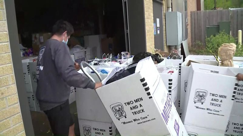 """Two Men and a Truck crews help deliver items to shelters for """"Movers for Moms."""""""