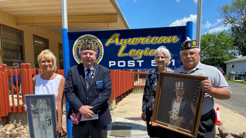 Members of American Legion Post 501 and Lynn Duesing, Bill Leppien's daughter (left),...