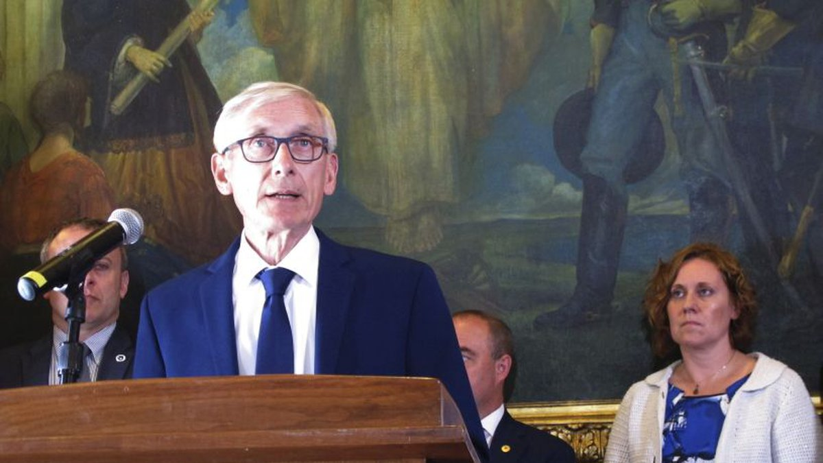 FILE - In this June 20, 2019, file photo, Wisconsin Gov. Tony Evers, surrounded by Democratic...