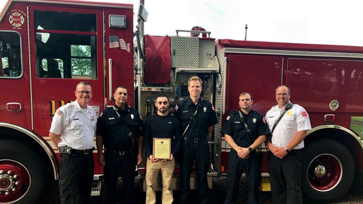 Luis Mendoza is honored for his bravery by the Beloit Fire Dept. on July 1, 2019.