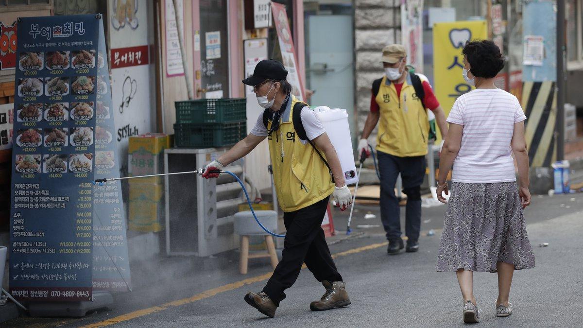 People disinfect as a precaution against the coronavirus in Seoul, South Korea, Saturday, Aug....