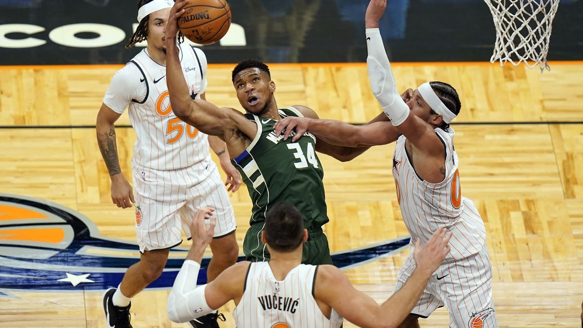 Milwaukee Bucks forward Giannis Antetokounmpo (34) tries to get control of a loose ball between...