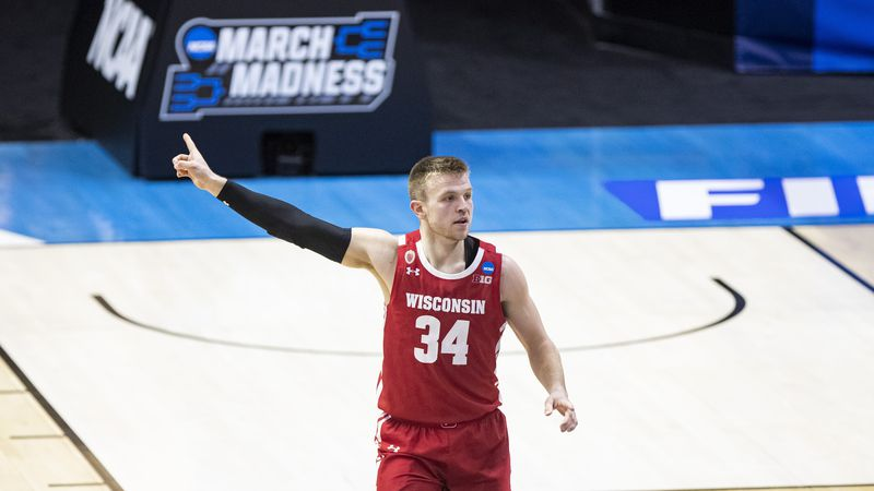 Wisconsin's Brad Davison (34) on the court during a first round game against North Carolina in...