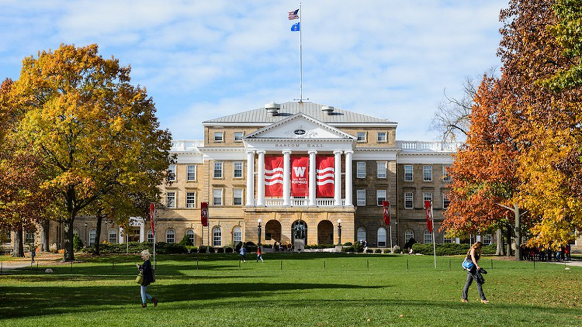 Pedestrians and students walk across Bascom Hill at the University of Wisconsin-Madison as the...