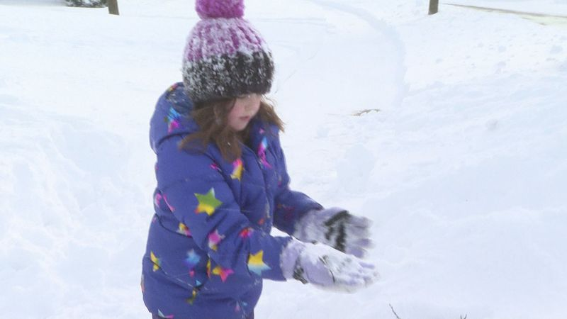 Six-year-old Amelia plays in the snow