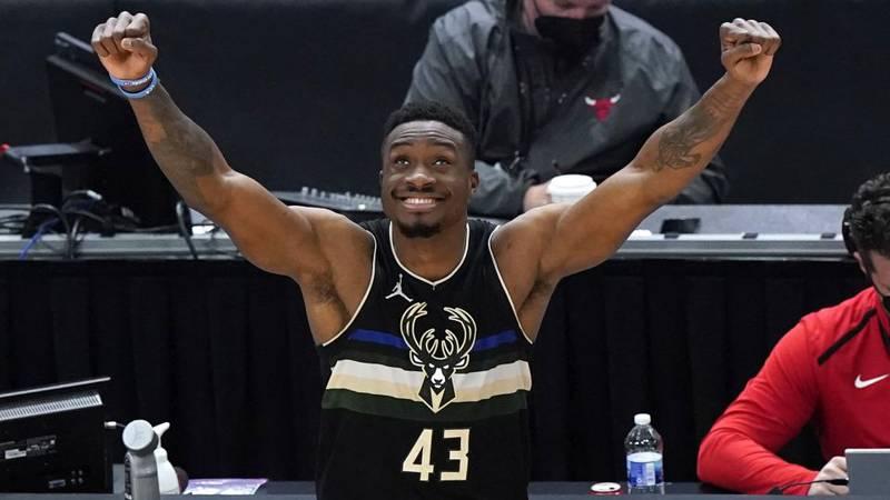 Milwaukee Bucks forward Thanasis Antetokounmpo looks up the score board as celebrates after...
