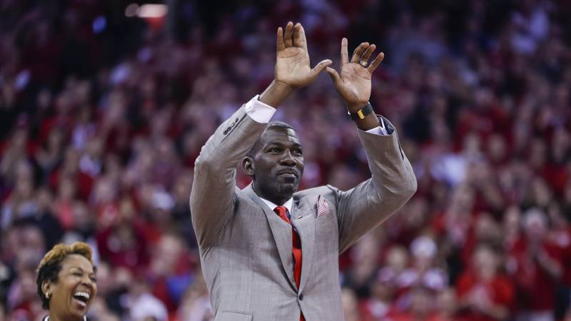 Former Wisconsin basketball player Michael Finley is honored during a timeout in an NCAA...