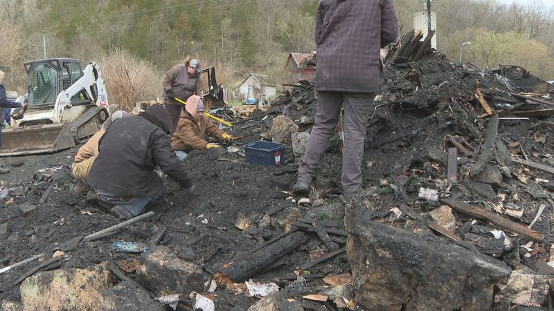 Wetter family and friends help dig through the ashes of what was once their home