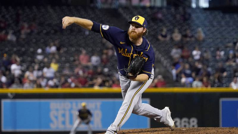 Milwaukee Brewers starting pitcher Brandon Woodruff throws against the Arizona Diamondbacks...