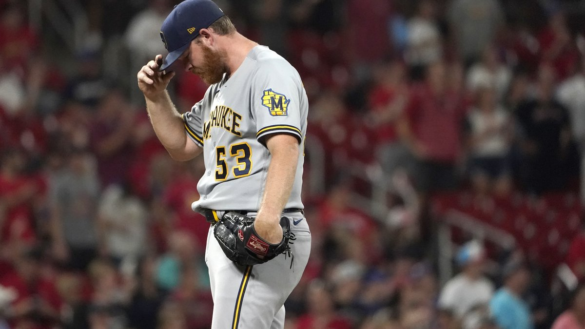 Milwaukee Brewers starting pitcher Brandon Woodruff pauses on the mound after giving up a solo...