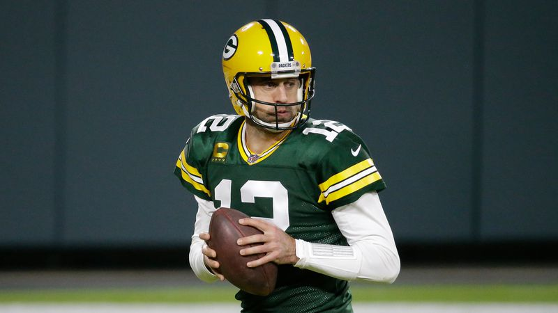 Green Bay Packers' Aaron Rodgers drops back during the second half of an NFL football game...