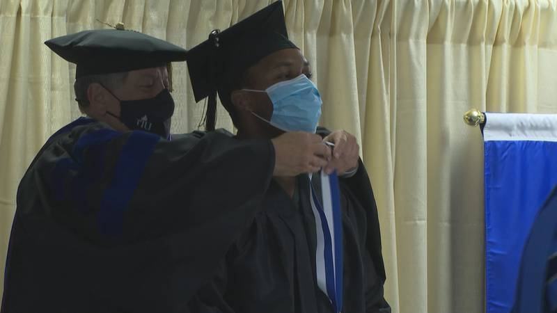 Graduate receives medal for earning education honors