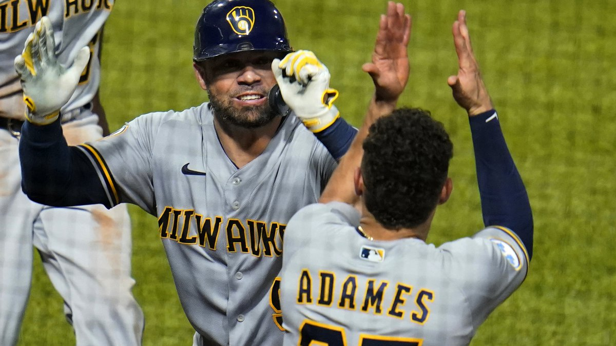 Milwaukee Brewers' Manny Pina, left, celebrates with Willy Adames (27) after hitting a two-run...