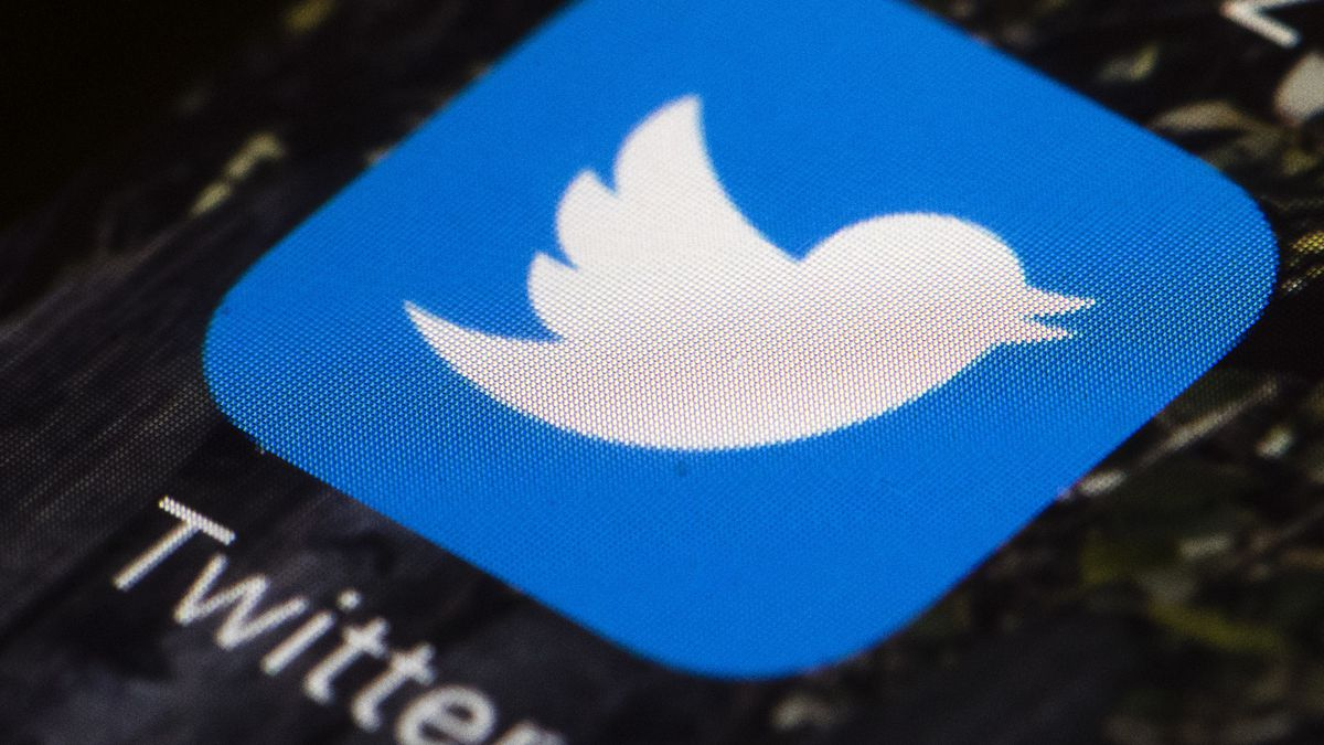 FILE - This April 26, 2017, file photo shows the Twitter app icon on a mobile phone in...