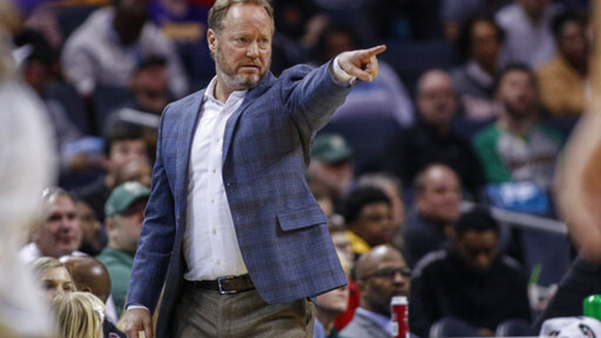 Milwaukee Bucks head coach Mike Budenholzer directs his team in the second half of an NBA basketball game against the Charlotte Hornets in Charlotte, N.C., Sunday, March 1, 2020. Milwaukee won 93-85. (AP Photo/Nell Redmond)