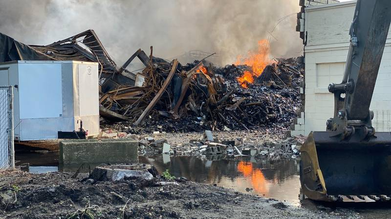 Fires continue to burn at a Fort Atkinson warehouse on August 11, 2021, a day after the fire.