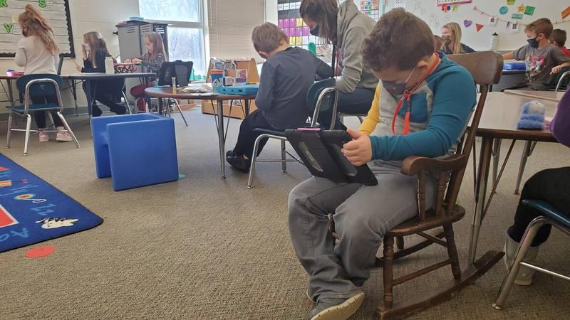 Kindergarten students at Van Buren Elementary school in Janesville learn the day's lessons