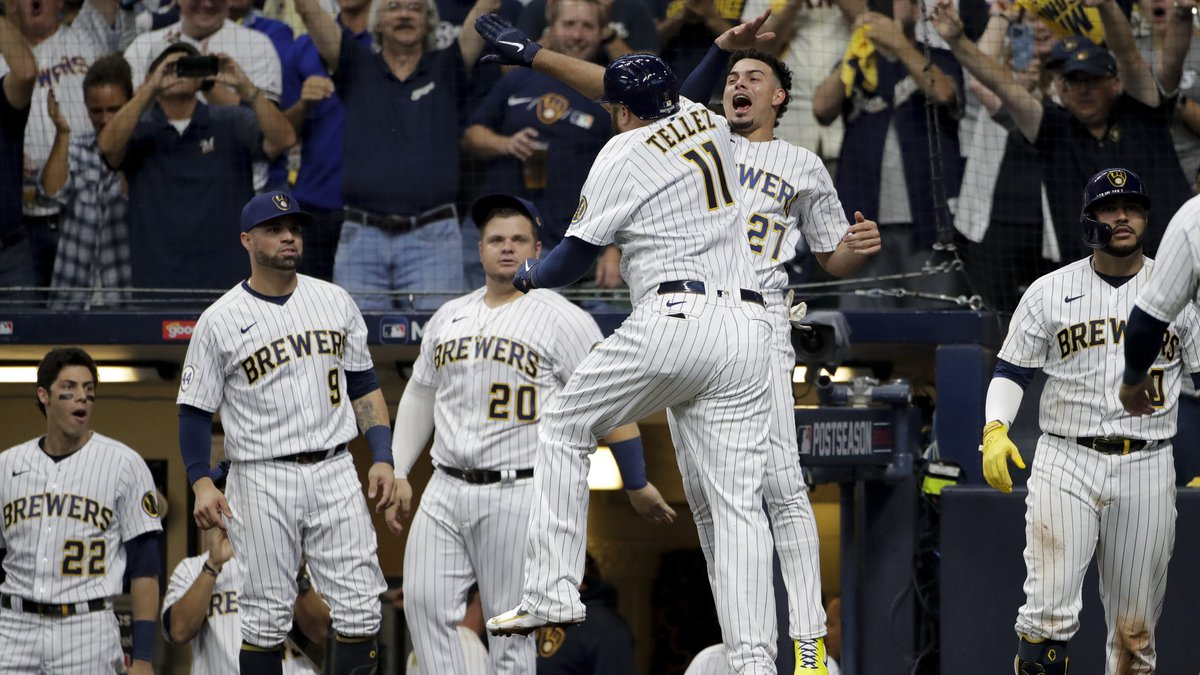 Milwaukee Brewers' Rowdy Tellez celebrates a two-run home run with Willy Adames during the...