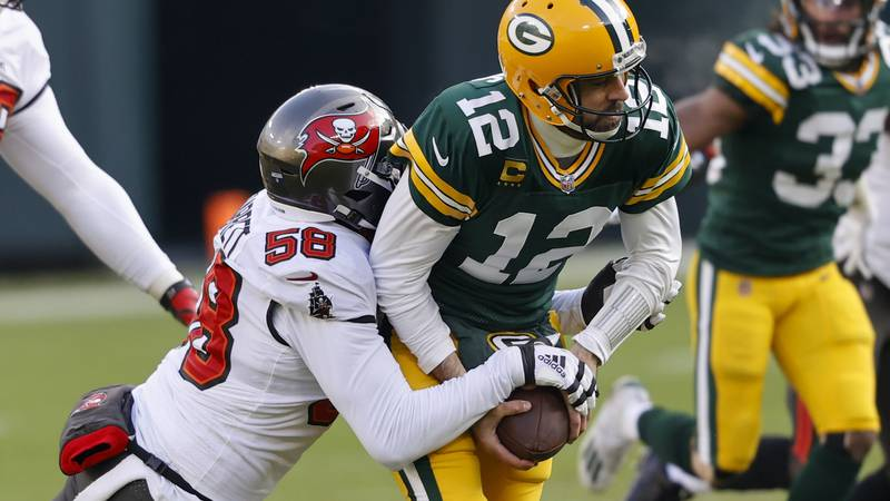Tampa Bay Buccaneers' Shaquil Barrett (58) sacks Green Bay Packers quarterback Aaron Rodgers...