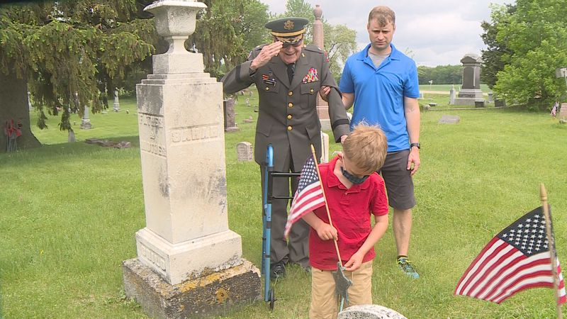 Despite recent health challenges, World War II Army veteran Lewis Harned placed flags on...