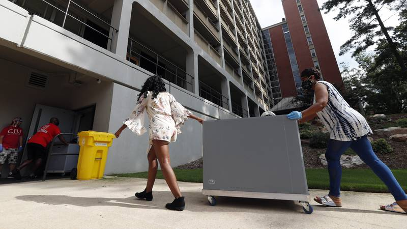 FILE - College students begin moving in for the fall semester at N.C. State University in...