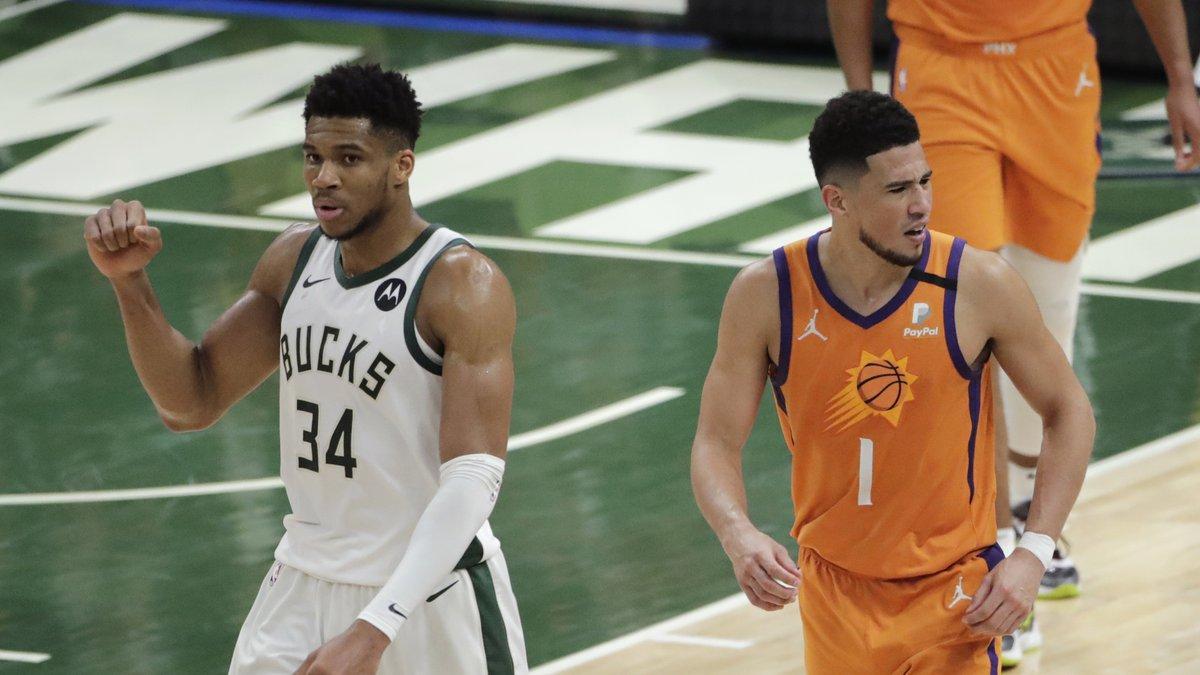 Milwaukee Bucks forward Giannis Antetokounmpo (34) celebrates in front of Phoenix Suns guard...