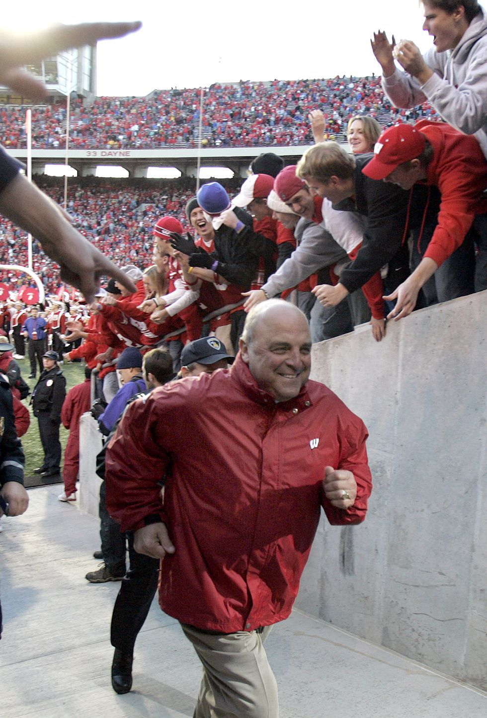 Wisconsin coach Barry Alvarez runs in the tunnel after Wisconsin beat Purdue 31-20 in Madison,...