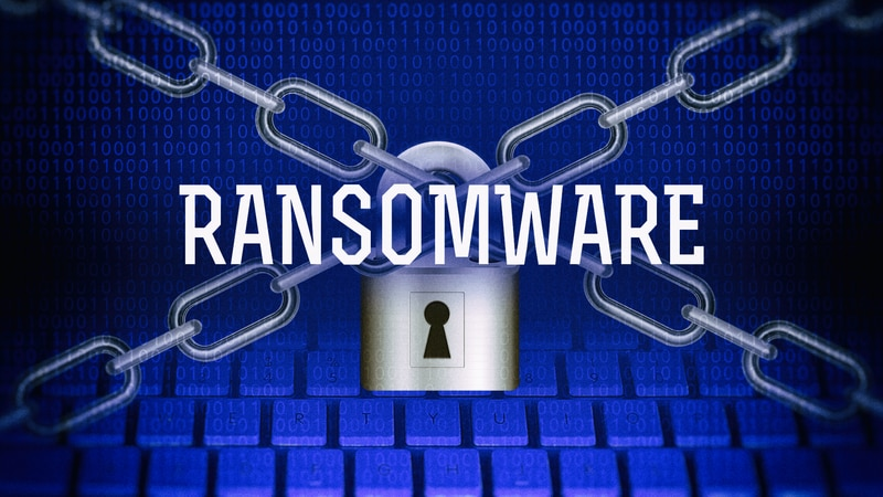 Metal chains and padlock over computer keyboard, drawing with RANSOMWARE lettering, finished...